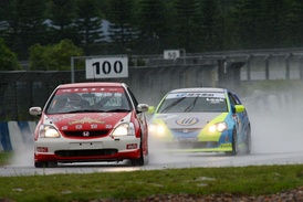 Paul Poon leads Kenneth Look in the rain at ZIC during a Hong Kong Touring Car Championship race.