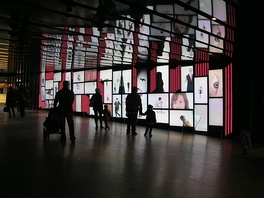 Digital artwork displayed on screens inside the Place des Arts cultural complex.