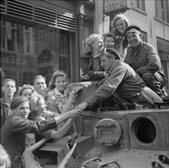 The crew of a Cromwell tank is welcomed by Dutch civilians in Eindhoven, 19 September 1944.