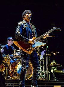 The Edge playing his signature guitar, the Gibson Explorer