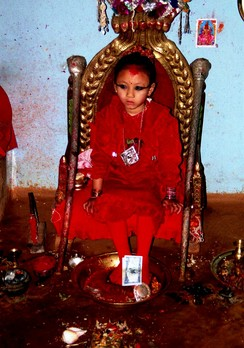 A Nepali girl being worshipped as a living Goddess, called a kumari
