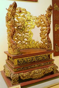 Ornate gold-and-wood throne-shaped altar