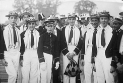 "Pupils at Eton College dressed as members of various rowing crews taking part in the ""Procession of Boats"" on the River Thames during the ""Fourth of June"" celebrations 1932"