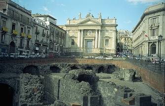 The Roman amphitheatre of Catania [it] (perhaps 2nd century AD) and in the background the Church of San Biagio, Catania [it; Church of San Biagio], built in the 18th century after the massive earthquake of 1693 on the location where tradition claims St Agatha was martyred in a furnace