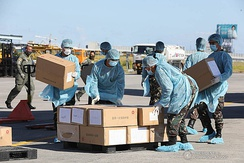 Medical supplies donated by China being received at Villamor Air Base in the Philippines