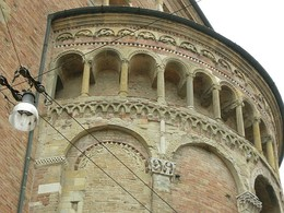 The eastern apse of Parma Cathedral, Italy (early 12th century) combines a diversity of decorative features: blind arcading, galleries, courses and sculptured motifs.