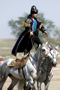 A Kazakhstan performer demonstrates the long equestrian heritage as part of the gala concert during the opening ceremonies of the Central Asian Peacekeeping Battalion