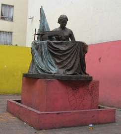 Bronze statue of a seamstress at corner of Manuel J Othón and San Antonio Abad at site of collapsed factory