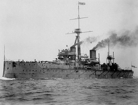 HMS Dreadnought; the 1902, 1904 and 1907 agreements with Japan, France and Russia allowed Britain to refocus resources during the Anglo-German naval arms race.