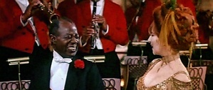 Louis Armstrong as the orchestra leader with Barbra Streisand, singing the song in the 1969 film.