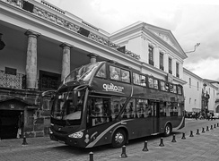 A Double-decker bus in front of the Presidential Palace in the Historic Center of Quito - World Heritage Site by UNESCO
