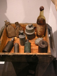 A display of improvised munitions, including a Molotov cocktail, from the Warsaw uprising, 1944
