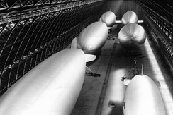 A view of six helium-filled blimps being stored in one of the two massive hangars located at NAS Santa Ana, during World War II.