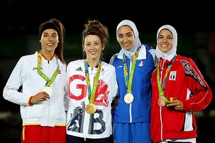 Taekwondo medallists from Spain, Britain, Egypt and Iran at the 2016 Summer Olympics, including two hijabi women.