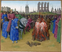 The burning of the pantheistic Amalrician heretics in 1210, in the presence of King Philip II Augustus. In the background is the Gibbet of Montfaucon and, anachronistically, the Grosse Tour of the Temple. Illumination from the Grandes Chroniques de France, c. A.D. 1455–1460.