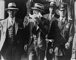 Mad Dog Coll leaving court surrounded by police officers, 1931