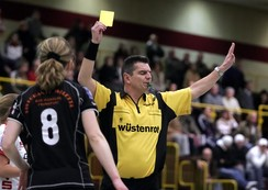 Yellow card shown in a handball match