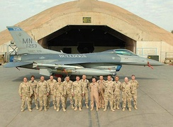 Airmen from the 148th in front of 179th Fighter Squadron F-16C[note 5]