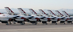 Thunderbirds F-16s (including three spare aircraft, for a total of nine) precisely lined up on the ramp at Nellis AFB just prior to the team's last performance of 2004.