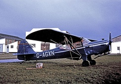 Auster Alpha parked in front of Auster's original assembly facilities at Rearsby in 1966