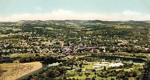 A 'bird's-eye' view of Brattleboro, looking westward from near the summit of New Hampshire's Mount Wantastiquet, taken in 1905. In the foreground is Island Park, a recreational area that was mostly washed away by floods in the early 20th century, before flood-control dams were built upriver.