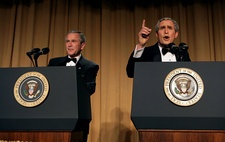 President George W. Bush (left) with Bush impersonator Steve Bridges in character (right) at the 2006 Dinner.