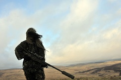 A sniper of 5 SCOTS (The Argyll and Sutherland Highlanders) during Exercise Boar's Head at Otterburn Training Area in February 2012.