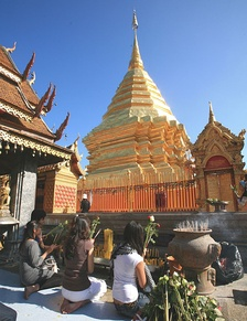 Worshippers making offerings to a chedi at Wat Doi Suthep, Chiang Mai