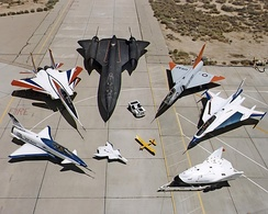 A collection of NASA experimental aircraft, including (clockwise from left) the X-31, F-15 ACTIVE, SR-71, F-106, F-16XL, X-38, Radio Controlled Mothership, and X-36.