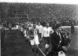Third Lanark (dark jerseys) and Zona Norte combined entering to the pitch, 10 June 1923