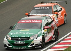 Fabrizio Giovanardi (leading Colin Turkington) driving for Vauxhall at the Oulton Park round of the 2006 British Touring Car Championship