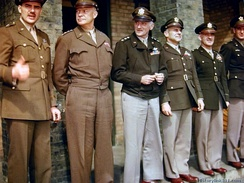 "Awards ceremony at RAF Debden, April 1944, illustrating varying shades of olive drab and the M-1944 ""Ike jacket"". Light shade 33 on left, dark shade 51 on right. Trousers are shade 33, khaki shade 1, and drab shade 54. The three combinations at right are ""pinks and greens"".[n 63]"