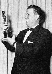 George Stevens holding his Oscar for Giant.