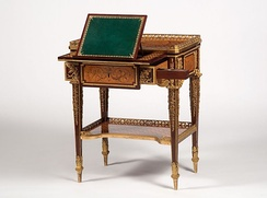 Jean-Henri Riesener's small writing table made for Marie-Antoinette – between 1780 and 1785, shows some of the queen's favorite flowers represented in the marquetry – including irises, lilacs, lilies, poppies, cornflower, and violets – species that she planted in the gardens of the Petit Trianon. The table can now be seen at Waddesdon Manor, a National Trust property in Buckinghamshire.