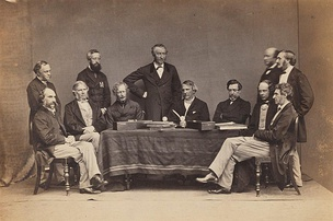 Maine, sitting second from right, with John Lawrence, Viceroy of India and other council members and secretaries in Simla, India, by Bourne & Shepherd, circa 1864.