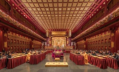 Buddhist monks and nuns praying in the Buddha Tooth Relic Temple of Singapore