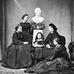 Victoria's five daughters (Alice, Helena, Beatrice, Victoria and Louise), photographed wearing mourning black beneath a bust of their late father, Prince Albert (1862)