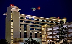 Night arrival of medical transport helicopter at Renown Regional Medical Center
