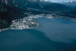 Aerial view of Seward, Alaska in the 1990s, looking north. The mouth of the Resurrection River and the base of Mount Marathon are visible.