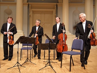 A modern string quartet. In the 2000s, string quartets from the Classical era are the core of the chamber music literature. From left to right: violin 1, violin 2, cello, viola