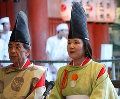 Shinto priest and priestess.