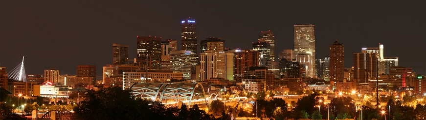 The skyline of downtown Denver with Speer Boulevard in the foreground