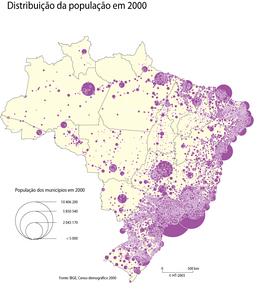 A map of Brazil, with purple circles denoting areas of high population in the year 2000. A large majority of the circles line Brazil's eastern coast.