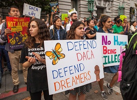 Protesters hold various signs and banners at a Deferred Action for Childhood Arrivals (DACA) rally in San Francisco.
