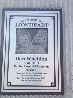 Dan Wheldon memorial plaque located adjacent to the course layout.