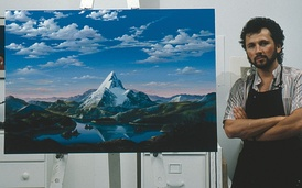 Artist Dario Campanile poses with a picture Paramount commissioned him to paint for its 75th anniversary in 1987. The company later used the painting as a basis for its new logo. That logo was introduced as a prototype in the 1986 film The Golden Child; the 1987 film Critical Condition was the first to feature the finalized version of the logo. 1999's South Park: Bigger, Longer & Uncut was the first to use an enhanced version of the logo, which was last used on 2002's Crossroads.