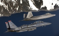 An F-15E Strike Eagle and an F-22 Raptor fly over the coast of Prince William Sound, Alaska. Both aircraft are from Elmendorf Air Force Base, Alaska, 2007