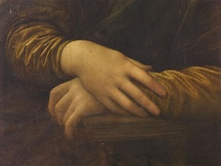 Detail of Lisa's hands, her right hand resting on her left. Leonardo chose this gesture rather than a wedding ring to depict Lisa as a virtuous woman and faithful wife.[79]