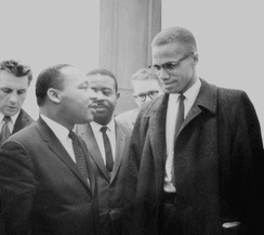 Martin Luther King, Jr. and Malcolm X meeting before a press conference after the Senate debate on the Civil Rights Act of 1964. This was the only time the two men ever met and their meeting lasted only one minute.[53]