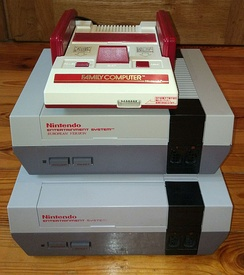 Comparison of NES from different regions. From top: Japanese Famicom, European NES and American NES